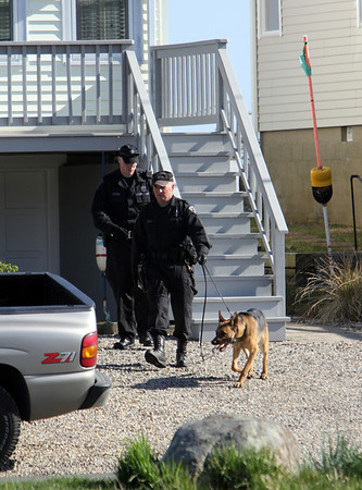 ALLEGRA BOVERMAN/Staff photo. Gloucester Daily Times. Rockport: At least two K-9 units were searching from house to house on Glenmere Street in the vicinity where Caleigh Harrison, 2 1/2, of Gloucester, went missing on Thursday.