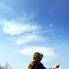 Maggie Valvano, who turns 10 next week, flies her kite at Stage Fort Park on Monday afternoon with her mom and two sisters. Jesse Poole/Gloucester Daily Times April 16, 2012