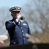 ALLEGRA BOVERMAN/Staff photo. Gloucester Daily Times. Gloucester: John Collins of the U.S. Coast Guard Auxiliary performs taps on Tuesday during the graveside service for Capt. Michael Ryan McCaddon, M.D. He was given full military honors for his funeral at St. Ann Church and Cavalry Cemetery.