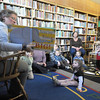 Manchester: Childrens librarian Sara Collins reads to a group of toddlers at Mother Goose Story Time at the Library Wednesday. The weekly event features stories, songs, , hand clapping, feet stomping and poems. JIm Vaiknoras/staff photo