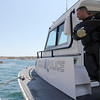 ALLEGRA BOVERMAN/Staff photo. Gloucester Daily Times. Rockport: The search for Caleigh Harrison continues in the Cape Hedge Beach and Long Beach areas of Rockport on Wednesday. State Police marine unit diver Anthony Vorias, of Rockport, awaits the next round of dives after a quick break for lunch on Wednesday. He knows these waters well, having grown up in Rockport, and also said he's never seen anything like this search.