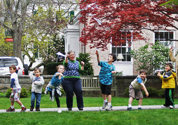 A group of Manchester kids gather outside the Manchester Public Library to toss their homemade paper airplanes in a competition measuring who's could fly the farthest in the second Annual Paper Airplane Contest on Thursday afternoon. Jesse Poole/Gloucester Daily Times April 26, 2012