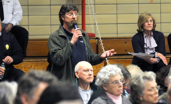 Manchester: Manchester Harbor Master Bion Pike speaks at Manchester's  Annual towm meeting at the Manchester Memorial Elementary School Monday night. Jim Vaiknmoras/staff photo
