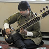 Rockport: Chirag Katti playes the sitar during a demostration of Indian music at the Rockport Elementary School by musisians Matt Pert and . Sponsored by Rockport Music, the event was part of a program to bring music from other cultures to the school. Jim Vaiknoras/staff photo