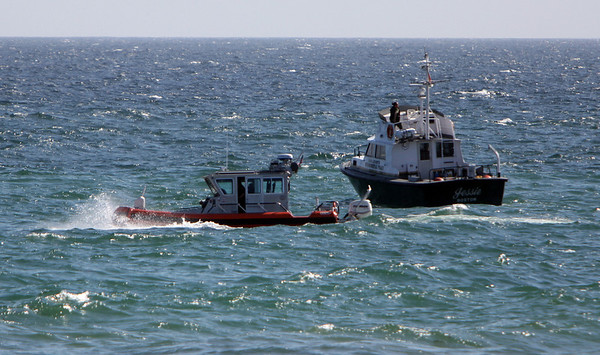 ALLEGRA BOVERMAN/Staff photo. Gloucester Daily Times. Rockport: Boats, including some from the U.S. Coast Guard, were along the Long Beach and Cape Hedge Beach areas searching for Caleigh Harrison, 2 1/2, of Gloucester who went missing on Thursday on the Rockport side of the beach.