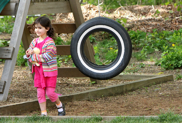 ALLEGRA BOVERMAN/Staff photo. Gloucester Daily Times. Gloucester: Lizzy Harrison, 4, of Gloucester, sister of missing toddler Caleigh Harrison, 2 1/2, who went missing last week, in her backyard playing with her cousins on Friday.