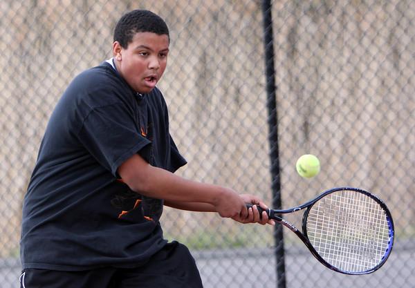 ALLEGRA BOVERMAN/Staff photo. Gloucester Daily Times. Gloucester: Cameron Davis, a Gloucester High School senior, plays on the Gloucester High School tennis team.