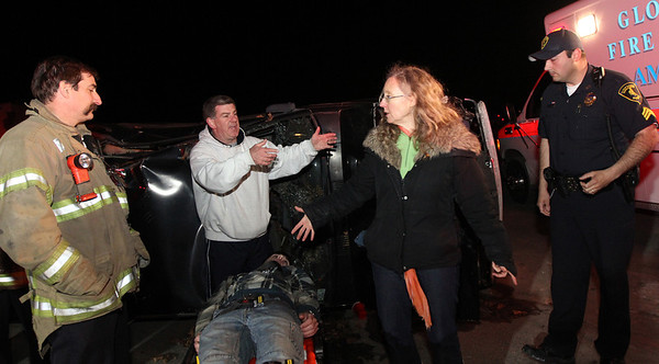 """ALLEGRA BOVERMAN/Staff photo. Gloucester Daily Times. Gloucester: During the filming of a public service announcement being made by the Healthy Gloucester Collaborative, at the Birdseye building parking lot along Pavilion Beach, Cape Ann TV video educator Lisa Smith, second from right, directs the Gloucester firefighters about how this particular scene, which shows an """"accident"""" while the """"driver"""" was intoxicated following his departure from a beach party with friends, will be filmed. Around her, from left are: Capt. Tom Logrande, Acting Fire Chief Steve Aiello, """"drunk driver"""" Patrick Tremblay, 21, of Gloucester, and Sgt. Michael Grossom of the Gloucester Police Department."""