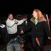 "ALLEGRA BOVERMAN/Staff photo. Gloucester Daily Times. Gloucester: During the filming of a public service announcement being made by the Healthy Gloucester Collaborative, at the Birdseye building parking lot along Pavilion Beach, Cape Ann TV video educator Lisa Smith, second from right, directs the Gloucester firefighters about how this particular scene, which shows an ""accident"" while the ""driver"" was intoxicated following his departure from a beach party with friends, will be filmed. Around her, from left are: Capt. Tom Logrande, Acting Fire Chief Steve Aiello, ""drunk driver"" Patrick Tremblay, 21, of Gloucester, and Sgt. Michael Grossom of the Gloucester Police Department."