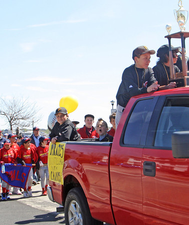 Piled in the bed of a truck, the Pirates lead the pack of little leaguers down Western Avenue and on toward Stage Fort Park in the Gloucester Little League Parade on Saturday morning. Jesse Poole/Gloucester Daily Times April 28, 2012