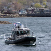 ALLEGRA BOVERMAN/Staff photo. Gloucester Daily Times. Rockport: State environmental police were helping to search the waters of Long Beach in Rockport on Friday. They were coming into the Old Granite Pier area here to confer with State Police Marine Unit personnel.