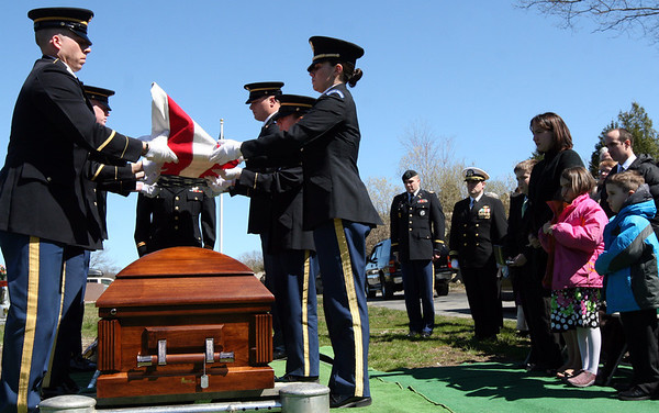 ALLEGRA BOVERMAN/Staff photo. Gloucester Daily Times. Gloucester: Capt. Michael Ryan McCaddon, M.D. M.D. was given full military honors for his funeral at St. Ann Church and Cavalry Cemetery on Tuesday. His family looks on at right.