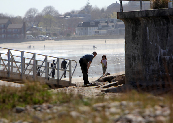 ALLEGRA BOVERMAN/Staff photo. Gloucester Daily Times. Rockport: Lizzy Harrison, 4, sister of Caleigh Harrison, 2 1/2, talks with a police officer about where she and her sister and mother were playing on Thursday along Long Beach on the Rockport side next to Cape Hedge Beach before Caleigh disappeared.