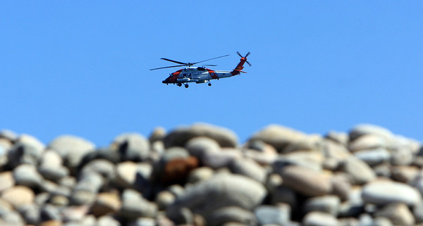 ALLEGRA BOVERMAN/Staff photo. Gloucester Daily Times. Rockport: A U.S. Coast Guard helicopter flies around the Long Beach and Cape Hedge Beach areas searching for Caleigh Harrison, 2 1/2, of Gloucester who went missing on the Rockport side of the beach on Thursday.