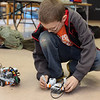 ALLEGRA BOVERMAN/Staff photo. Gloucester Daily Times. Rockport: Zak Poretta, a fifth grader at Rockport Elementary School, works with his robot during the Robotics Club meeting on Monday afternoon at the school. The club is new to the school this academic year and runs for 6-7 weeks at a time. It is run by volunteer and engineer Eric Wilson, who works at Varian in Gloucester. Varian has donated several laptops and matched donations for the club.
