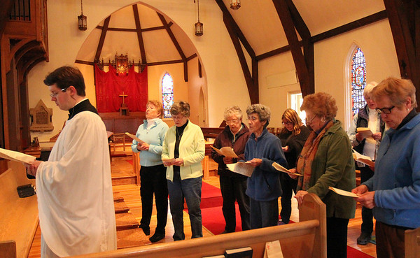 ALLEGRA BOVERMAN/Staff photo. Gloucester Daily Times. Gloucester: During The Way of the Cross service inside the St. John's Episcopal Church sanctuary on Friday. The Rev. Bret Hays presided at far left.