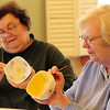 ALLEGRA BOVERMAN/Staff photo. Gloucester Daily Times. Rockport: Pat Brown, right, and Helen Barnett, both of Rockport, paint bowls on Wednesday at Rockport Council on Aging at Community House for the upcoming Open Door Empty Bowl Dinner on Thurs., May 10 from 4-8 p.m. at Cruiseport Gloucester.