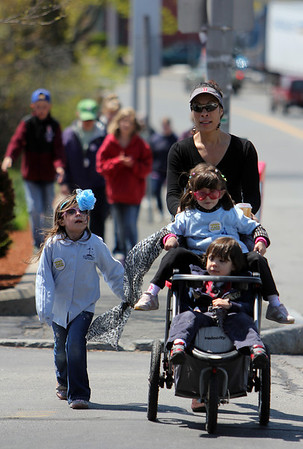 ALLEGRA BOVERMAN/Staff photo. Gloucester Daily Times. Gloucester: About 400 people walked in the 25th Annual Pride Stride through Gloucester on Sunday. Walking up Rogers Street are: Giovanna Taylor, pushing Mariana Debenedict, 4, Taylor's son Alexander, 3, and at left, Halia Taylor, 5.