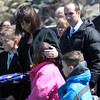 ALLEGRA BOVERMAN/Staff photo. Gloucester Daily Times. Gloucester: Leslie McCaddon, second from left, with her children Kyler, 10, Madeleine, 8, and Lucas, 6, at the graveside service for her husband Capt. Michael Ryan McCaddon, M.D. at Calvary Cemetery on Tuesday.