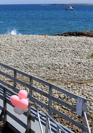 ALLEGRA BOVERMAN/Staff photo. Gloucester Daily Times. Rockport: The State Police divers were searching Long Beach and Cape Hedge Beach waters on Thursday. This is a view from Long Beach's boardwalk towards Cape Hedge Beach. Balloons have been placed on the footbridge over Saratoga Creek that joins the two beaches.