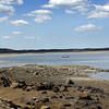 A low tide at Conomo Point in Essex hosts a lone sailboat on Friday. Jesse Poole/Gloucester Daily Times April 13, 2012