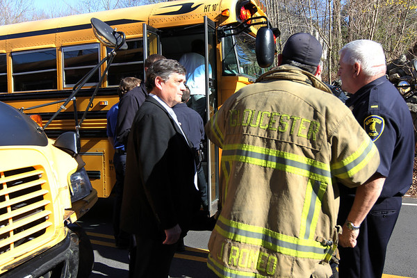 ALLEGRA BOVERMAN/Staff photo. Gloucester Daily Times. Gloucester: Brian C. Tarr, assistant superintendent of Gloucester Public Schools, left, was on the scene of a crash between a school bus and a work truck right outside West Parish Elementary School on Tuesday at the end of the school day.