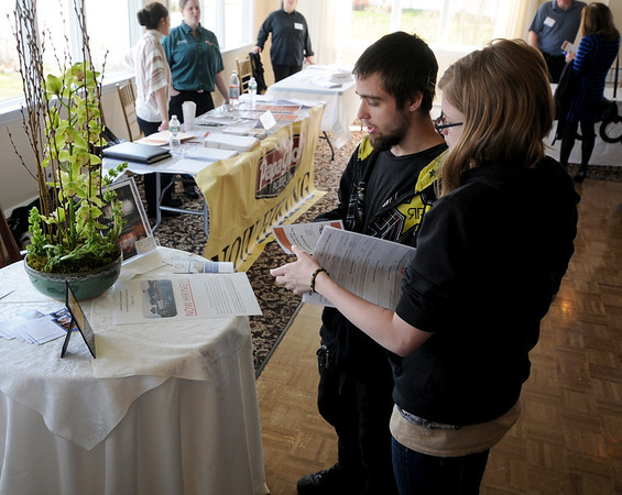 Gloucester: Zachary Allen and Meaghan McNutt pick up job application at the Job Fair at the Elks in Gloucester Tuesday. Jim Vaiknoras/staff photo<br /> , Gloucester: Zachary Allen and Meaghan McNutt pick up job application at the Job Fair at the Elks in Gloucester Tuesday. Jim Vaiknoras/staff photo