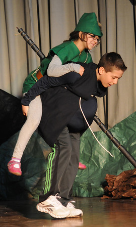 "Gloucester: Sophie Hogan-Lopez as Robin Hood gets a ride from Rodney Nyborg as Fryer Tuck in ""The Enchanted Oak"" play at Plum Cove Elementary School Thursday. The play performed by the 4th and 5th grader at the school,is a collection of short stories directed by Jill Rogati and Nate Punches. Funded partly by the Gloucester Education Foundation."