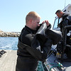ALLEGRA BOVERMAN/Staff photo. Gloucester Daily Times. Rockport: The search for Caleigh Harrison continues in the Cape Hedge Beach and Long Beach areas of Rockport on Wednesday. State Police marine unit divers Jay Macomber, front, and Anthony Vorias, upper right, who is from Rockport, ready for their next dive after a quick break for lunch.