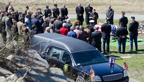 DESI SMITH/Gloucester Daily Times. Gloucester: Full military honors were given to Capt. Michael Ryan McCaddon, M.D. at Calvary Cemetery on Tuesday afternoon. The 54th Massachusetts Honor Guard of Milford was on hand to bestow the honors.