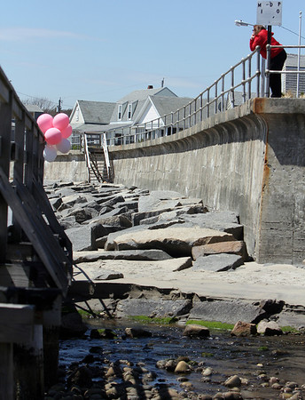 ALLEGRA BOVERMAN/Staff photo. Gloucester Daily Times. Rockport: Balloons have been placed on the footbridge over Saratoga Creek that joins Long Beach and Cape Hedge Beaches. Caleigh Harrison, 2 1/2, of Gloucester, went missing in this vicinity last week.