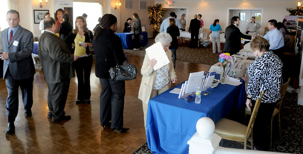 Gloucester:Job seekers talk with company representitives at the Job Fair at the Elks in Gloucester Tuesday. Jim Vaiknoras/staff photo
