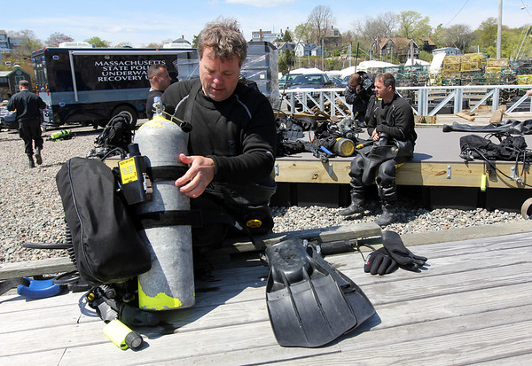 ALLEGRA BOVERMAN/Staff photo. Gloucester Daily Times. Rockport: The search for Caleigh Harrison continues in the Cape Hedge Beach and Long Beach areas of Rockport on Wednesday. State Police marine unit divers, including Sgt. Dave Mahon, front, were diving on Wednesday morning.