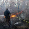 ALLEGRA BOVERMAN/Staff photo. Gloucester Daily Times. Gloucester: Mike Sonia of the Gloucester Fire Department attacks the leading edge of the fire in Dogtown on Thursday afternoon.