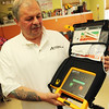 ALLEGRA BOVERMAN/Staff photo. Gloucester Daily Times. Gloucester: Jim Noble, Action's shelter manager, talks about the new defibrillator that the center has just received.
