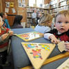 Manchester: Cayden Myers, left, and Freddy Jakes, take a break from the activities to do puzzles during Mother Goose Story Time at the Manchester Library Wednesday. The weekly event features stories, songs, , hand clapping, feet stomping and poems. JIm Vaiknoras/staff photo