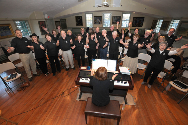 """Gloucester: Hiedi  Dallin plays piano as the cast sings"""" Putting on the Ritz"""" during  a""""Share the Music"""" rehearsal at Annisquam Town Hall. Jim Vaiknoras/staff photo"""