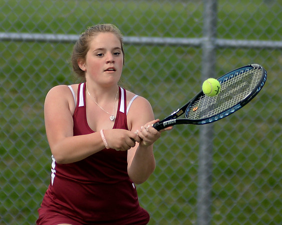 RYAN HUTTON/ Staff photo<br /> Gloucester's Katie Nugent returns the ball during her 1st Doubles match with partner Heidi Franke-Otten against Peabody's Chrisly Biqiku and Andeemae Sims during Monday's tennis match at Peabody High.