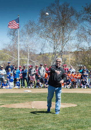 "Desi Smith/Staff photo.   Harold ""Bucky"" Rogers throws out the first pitch, soon after his children Tyler and Abby unveiled the new scorboard bearing his name, during a field dedication after the Gloucester Little League parade and season openner Saturday morning on Dr. Osman Babson Road.   April 30,2016"