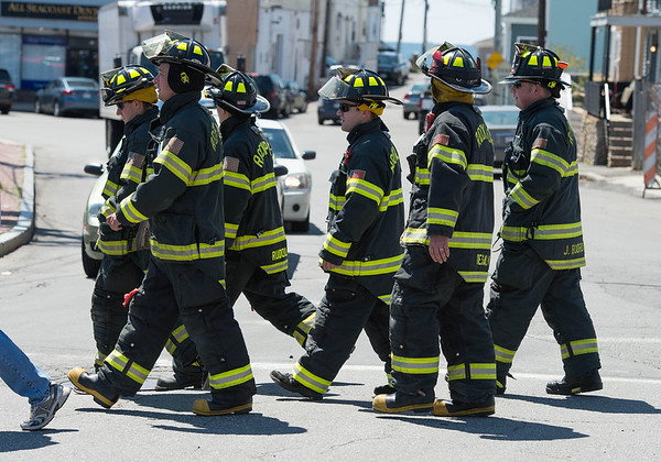 Desi Smith/Staff photo.    A group of Rockport firefighters make their way onto Rogers Street during the 29th Annual Pride Stride walking in full gear Sunday afternoon that started and ended at Stage Fort Park.   April 24,2016
