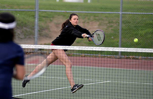 RYAN HUTTON/ Staff photo<br /> Gloucester's Heidi Franke-Otten follows through after batting the ball toward the net during her 1st Doubles match with partner Katie Nugent against Peabody's Chrisly Biqiku and Andeemae Sims during Monday's tennis match at Peabody High.