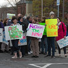 Desi Smith/Staff photo.   A group of supporters display their signs as they prepare to walk in the Annual Take Back the Night March to end domestic violence Thursday night. The march was led by Mayor Sefatia Romeo Theken along with HAWC and other groups, that started at City Hall steps, and then traveled down Main Street and stopped at Blackburn building parking lot for rally and speaking program.    April 28,2016