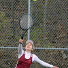 RYAN HUTTON/ Staff photo<br /> Gloucester's Lexi Zubrocki serves the ball to Peabody's Tori Thompson during their 1st Singles match during Monday's tennis match at Peabody High.