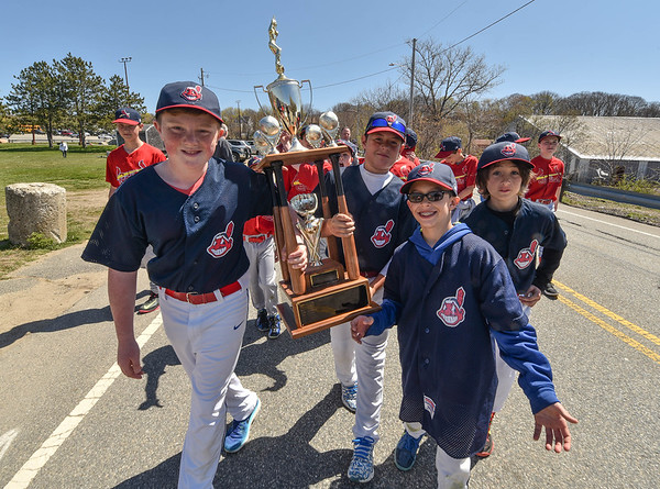 "Desi Smith/Staff photo.   Last years Magor A Indains proudly carry their throphy down Dr. Osman Babson Road during the Gloucester Little League parade and season openner Saturday morning on Dr. Osman Babson Road, where they also held a field dedication ceremony naming a new field in honor of Harold ""Bucky"" Rogers.      April 30,2016"