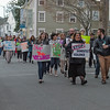 Desi Smith/Staff photo.   Mayor Sefatia Romeo Theken along with HAWC and other groups, head down Pleasent Street just after leaving City Hall, and then headed down Main Street were they stopped for rally and speaking program at Blackburn building parking lot for the Annual Take Back the Night March to end domestic violence Thursday night.     April 28,2016