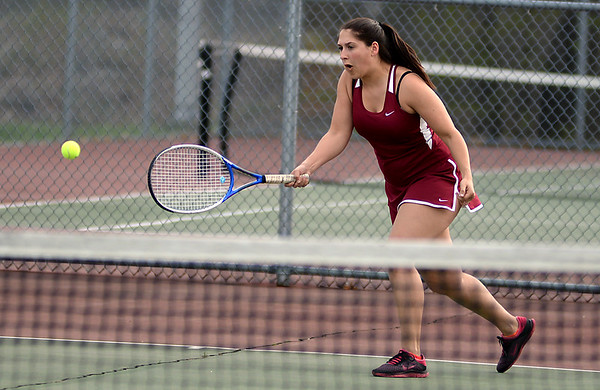 RYAN HUTTON/ Staff photo<br /> Gloucester's Tea Ryder dashes toward the ball during her 2nd Singles match against Peabody's Isabela Valencia during Monday's tennis match at Peabody High.