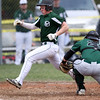 DAVID LE/Staff photo. Manchester-Essex's Chris Carr lunges towards the plate ahead of the tag from Pentucket catcher Jackson McKean (23). 4/23/16.