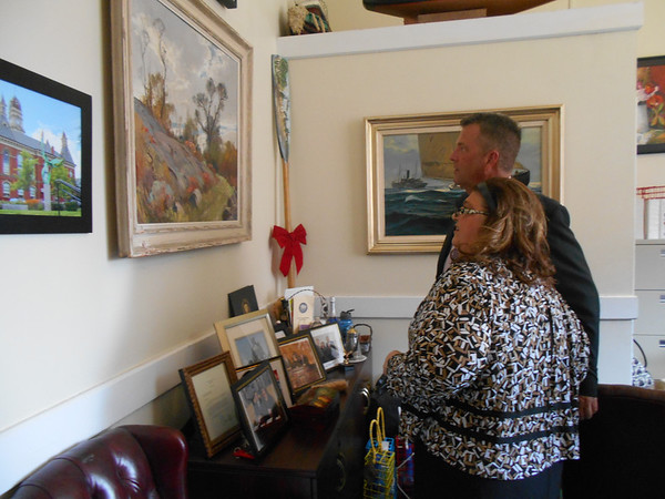 RAY LAMONT/Staff photo<br /> Mayor Sefatia Romeo Theken shows Daniel Smith of Gloucester, her newly apponted chief of administration, her office in City Hall. Smith, appointed for 90 days, starts the job May 16.