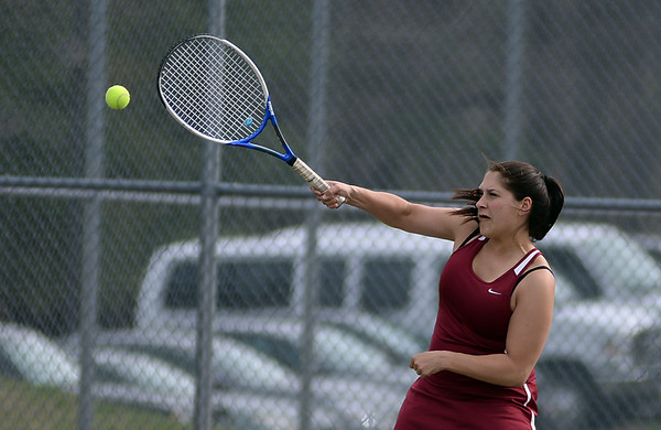RYAN HUTTON/ Staff photo<br /> Gloucester's Tea Ryder fires the ball over the net during her 2nd Singles match against Peabody's Isabela Valencia during Monday's tennis match at Peabody High.