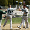 DAVID LE. Gloucester Times. Manchester-Essex catcher Alex Ray (15) left, congratulates pitcher Adrian Frattini (11) after he hit a 2-run home run in their game against Mystic Valley on Friday morning. 4/22/11.<br /> , DAVID LE. Gloucester Times. Manchester-Essex catcher Alex Ray (15) left, congratulates pitcher Adrian Frattini (11) after he hit a 2-run home run in their game against Mystic Valley on Friday morning. 4/22/11.